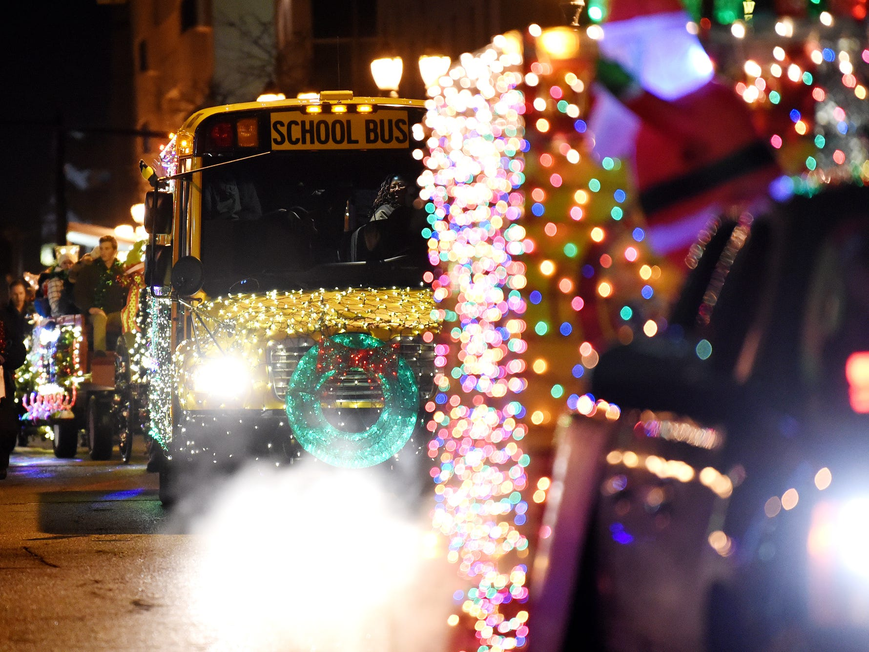 Floats covered in light make their way along the route during the Silver Bells in the City Electric Light Parade on Friday, Nov. 16, 2018, in downtown Lansing.