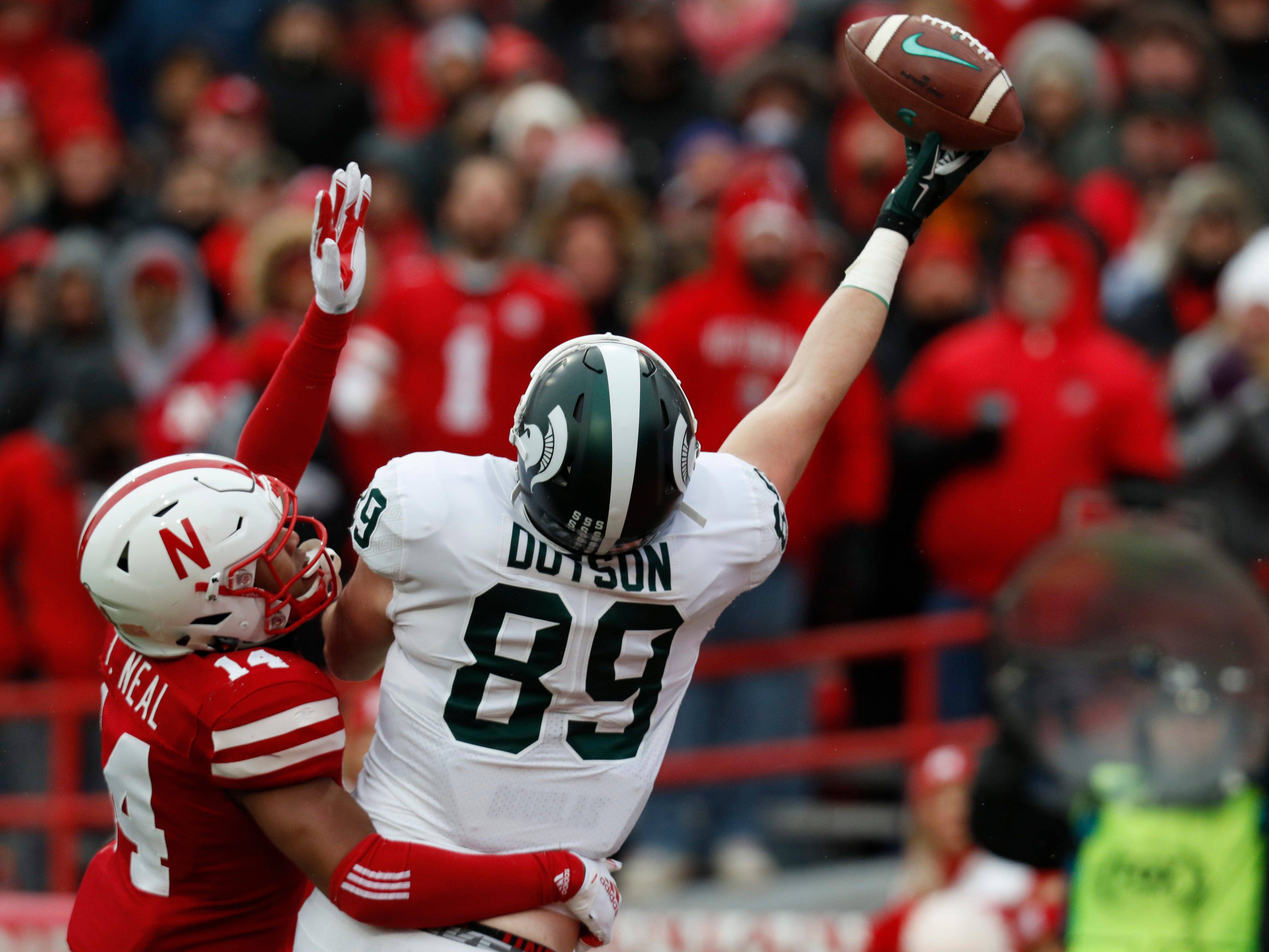 Michigan State tight end Matt Dotson can't quite haul in this touchdown pass against Nebraska Cornhuskers safety Tre Neal in the first half Saturday in Lincoln, Nebraska.