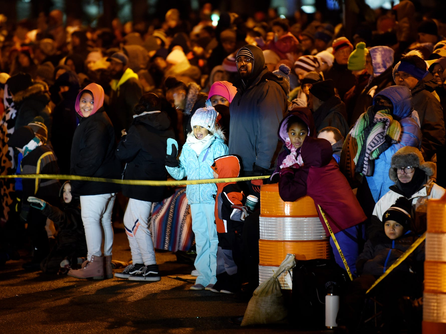 Spectators line Capitol Avenue during the Silver Bells in the City Electric Light Parade on Friday, Nov. 16, 2018, in downtown Lansing.
