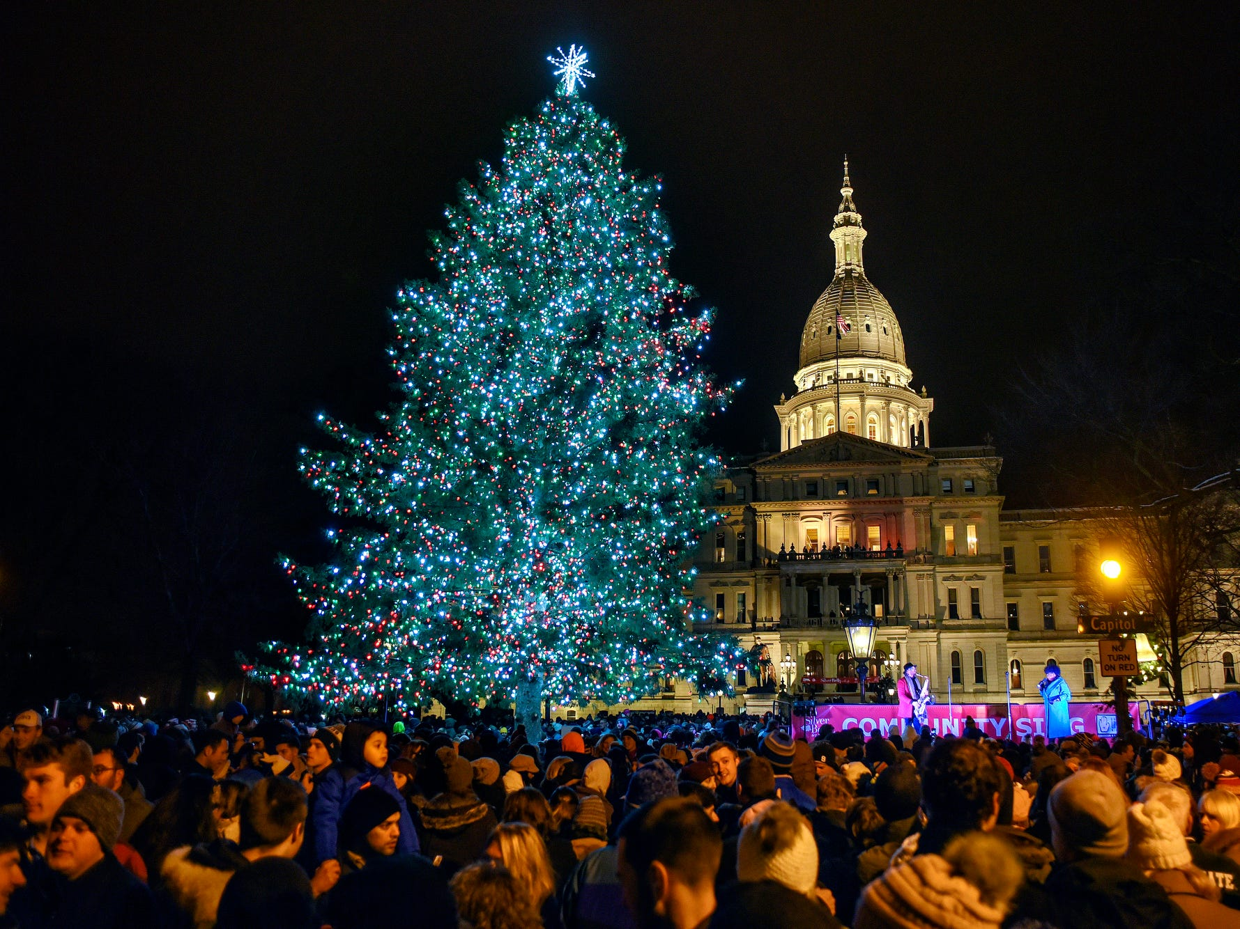 The official state Christmas tree shines in front of the Michigan State Capitol after a lighting ceremony during Silver Bells in the City on Friday, Nov. 16, 2018, in downtown Lansing.