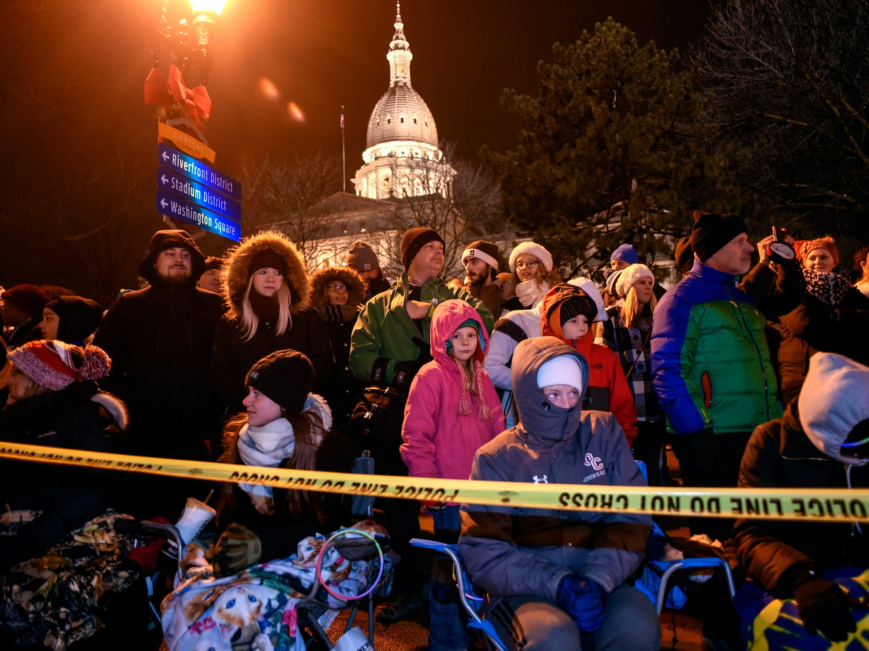 Spectators watch outside the Capitol during the Silver Bells in the City Electric Light Parade on Friday, Nov. 16, 2018, in downtown Lansing.