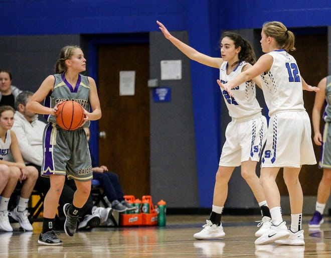 St. Mary's Springs girls basketball's Isabelle Coon (22) and Taylor Rowe (12) defend against Two Rivers High School's Emma Cooley during their game Friday, November 16, 2018 in Fond du Lac.