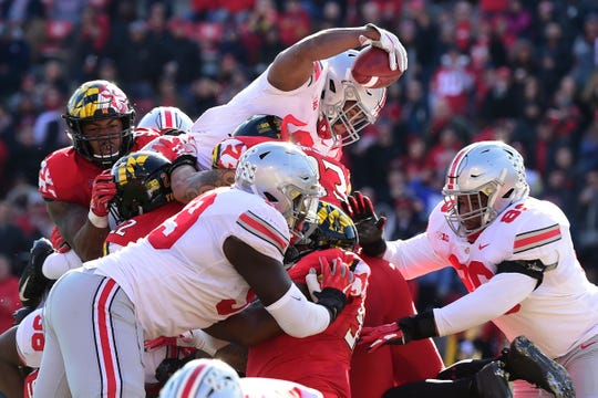 Ohio State tailback J.K. Dobbins dives over the pile for a touchdown in the second quarter of Saturday's 52-51 victory at Maryland.