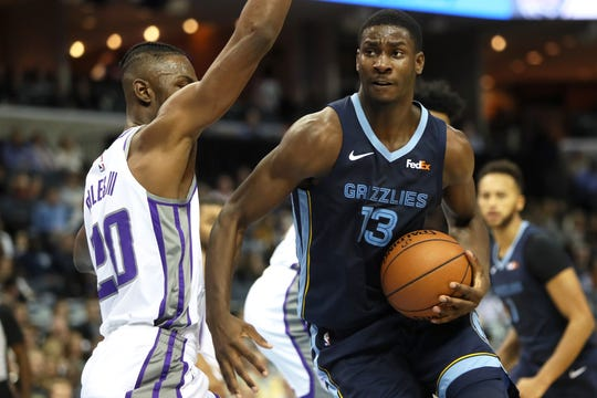 Memphis Grizzlies forward Jaren Jackson Jr. spins inside on Sacramento Kings defender Harry Giles during their game at the FedExForum on Friday, November 16, 2018.