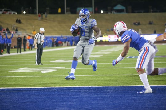 Memphis running back Patrick Taylor runs for one of his two touchdowns against SMU in the Tigers' 28-18 win Friday night.