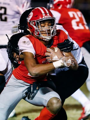 Germantown receiver Cameron Baker against the Whitehaven defense during action of their 6A state semifinal game in Germantown, Tenn.