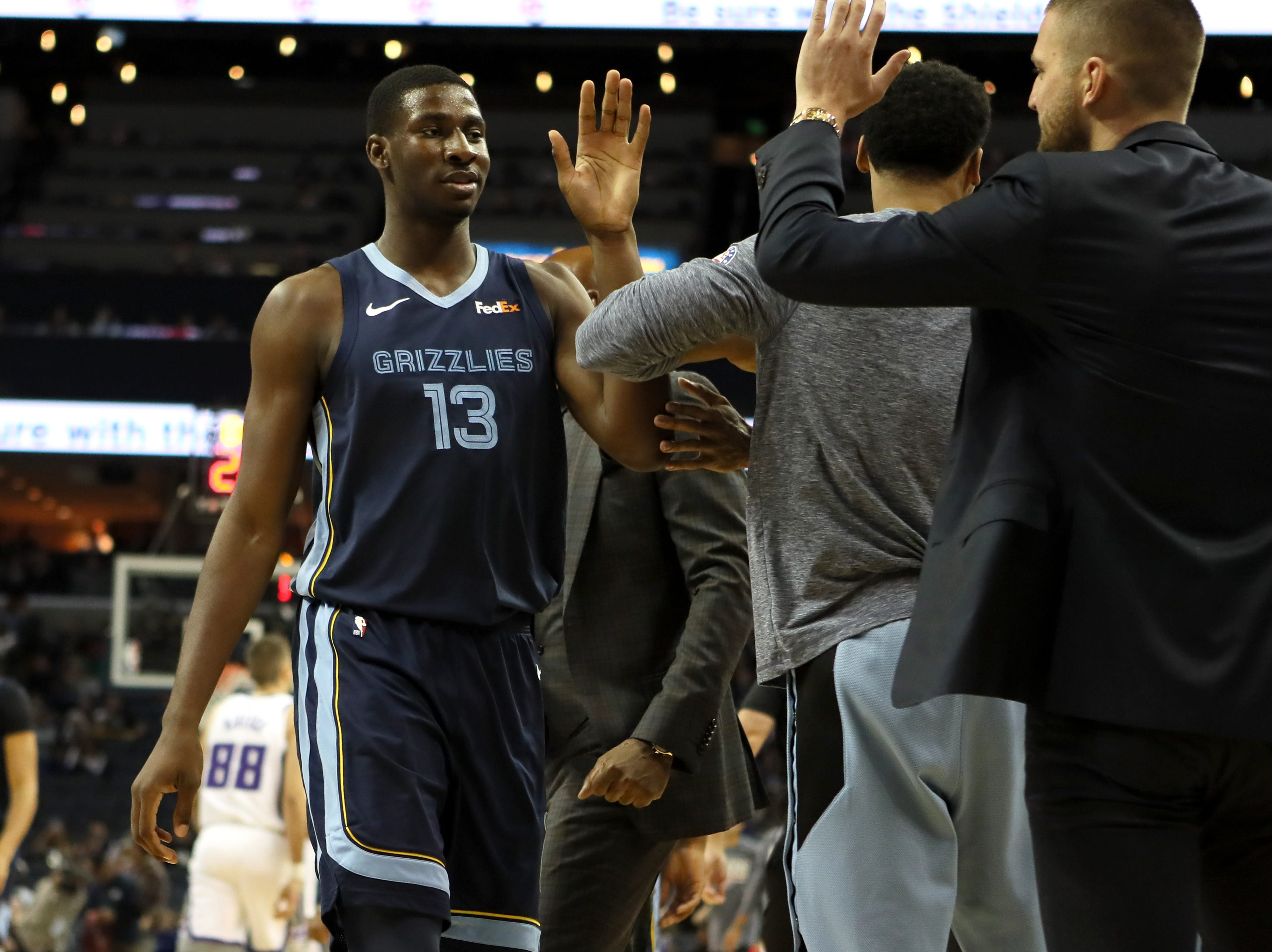 Memphis Grizzlies forward Jaren Jackson Jr. high-fives teammates during a timeout in ther game against the Sacramento Kings at the FedExForum on Friday, Nov. 16, 2018.