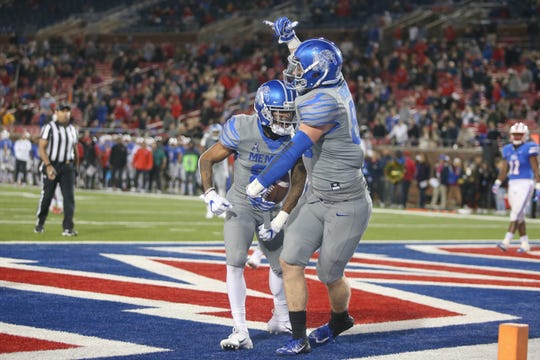Memphis tight end Joey Magnifico celebrates one of his two touchdowns against SMU Friday night in the Tigers' 28-18 road win on November 16, 2018