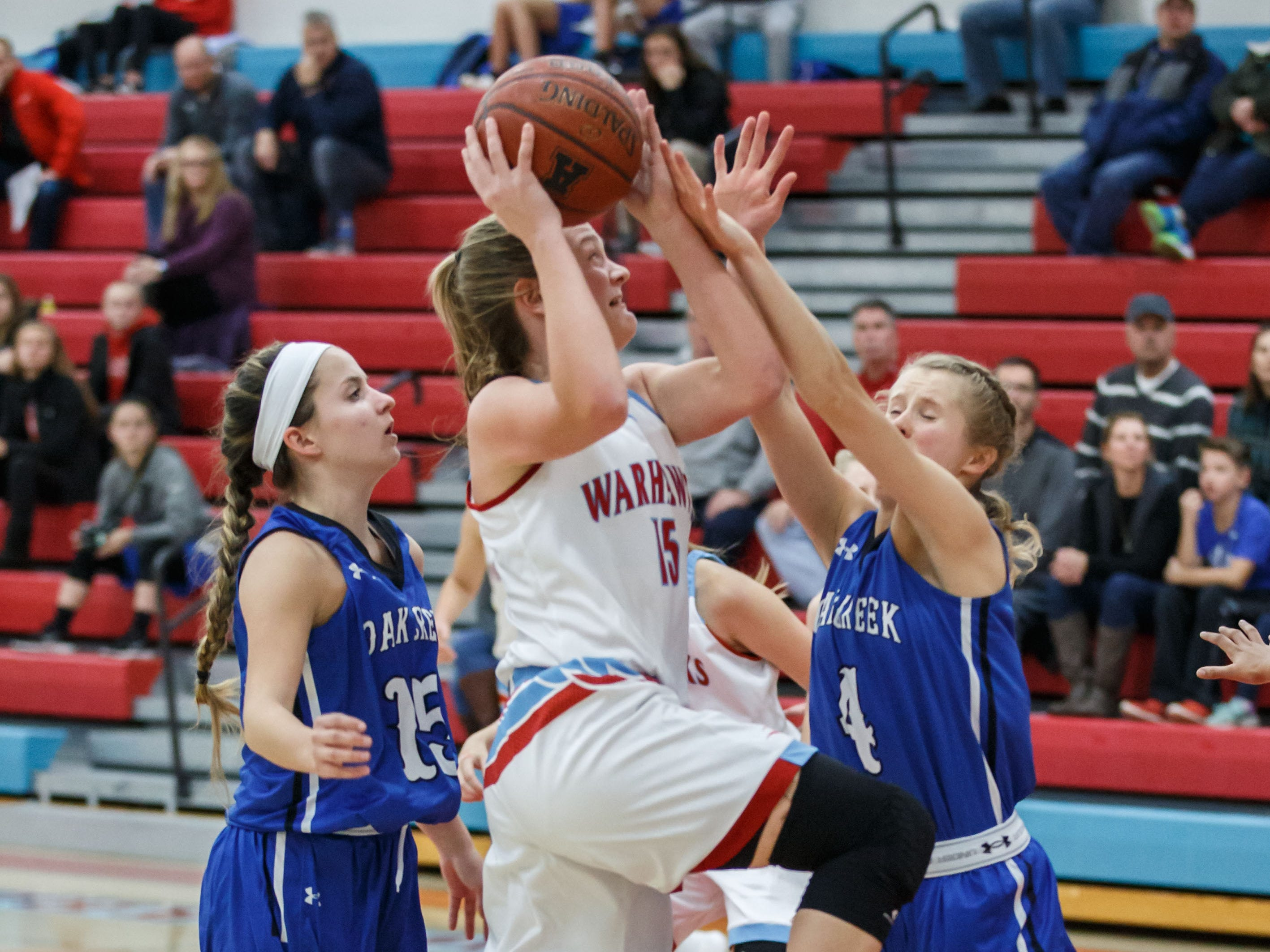 Arrowhead sophomore Phoebe Frentzel (15) drives in for a layup during the game at home against Oak Creek on Friday, Nov. 16, 2018.