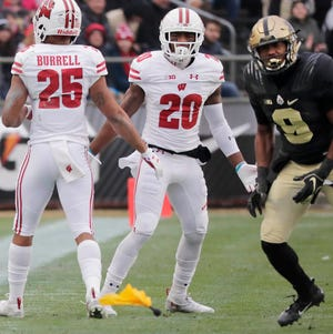 Badgers cornerback Faion Hicks is called for pass interference against Purdue Boilermakers running back Markell Jones.
