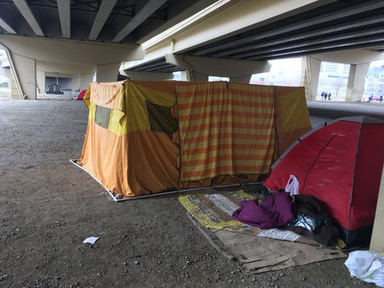 Tents under the I-94 overpass at North 6th and West Clybourn streets are home for dozens of people.