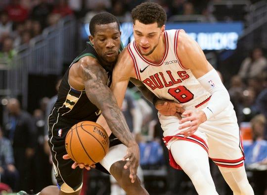 Bucks guard Eric Bledsoe steals the ball from   Bulls guard Zach LaVine.