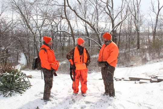 Mark Schack (left) of Tomah and his son, Matthew Schack (right) of Fitchburg talk with Will Kramer of Dodgeville after a morning hunt Saturday on land owned by Will's parents, Kent and Amy Kramer.