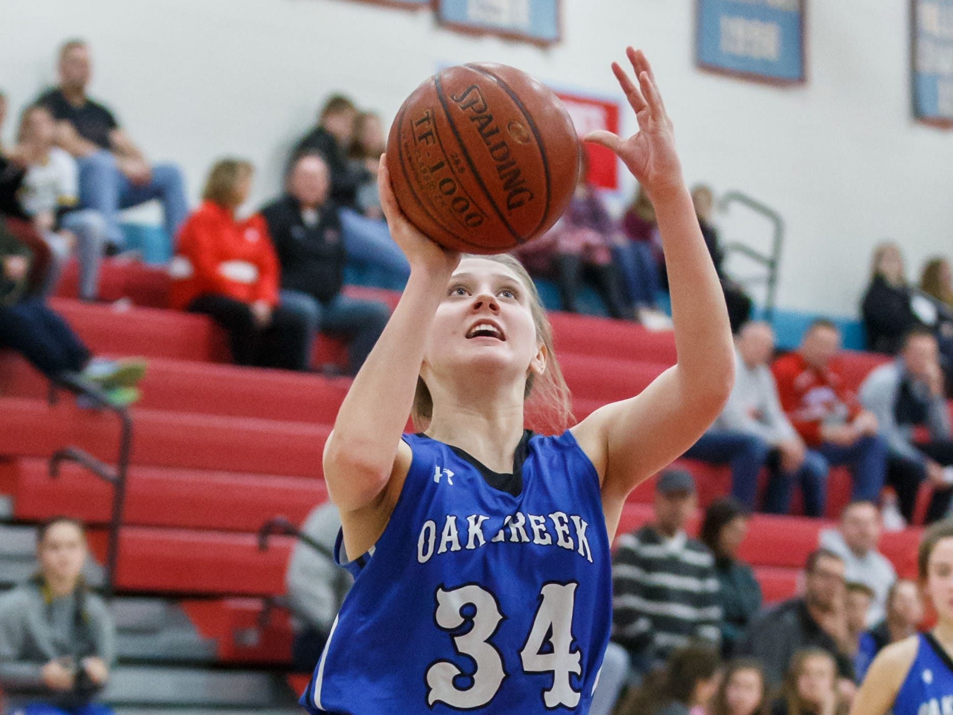 Oak Creek sophomore Jamie Finn (34) elevates for a shot during the game at Arrowhead on Friday, Nov. 16, 2018.
