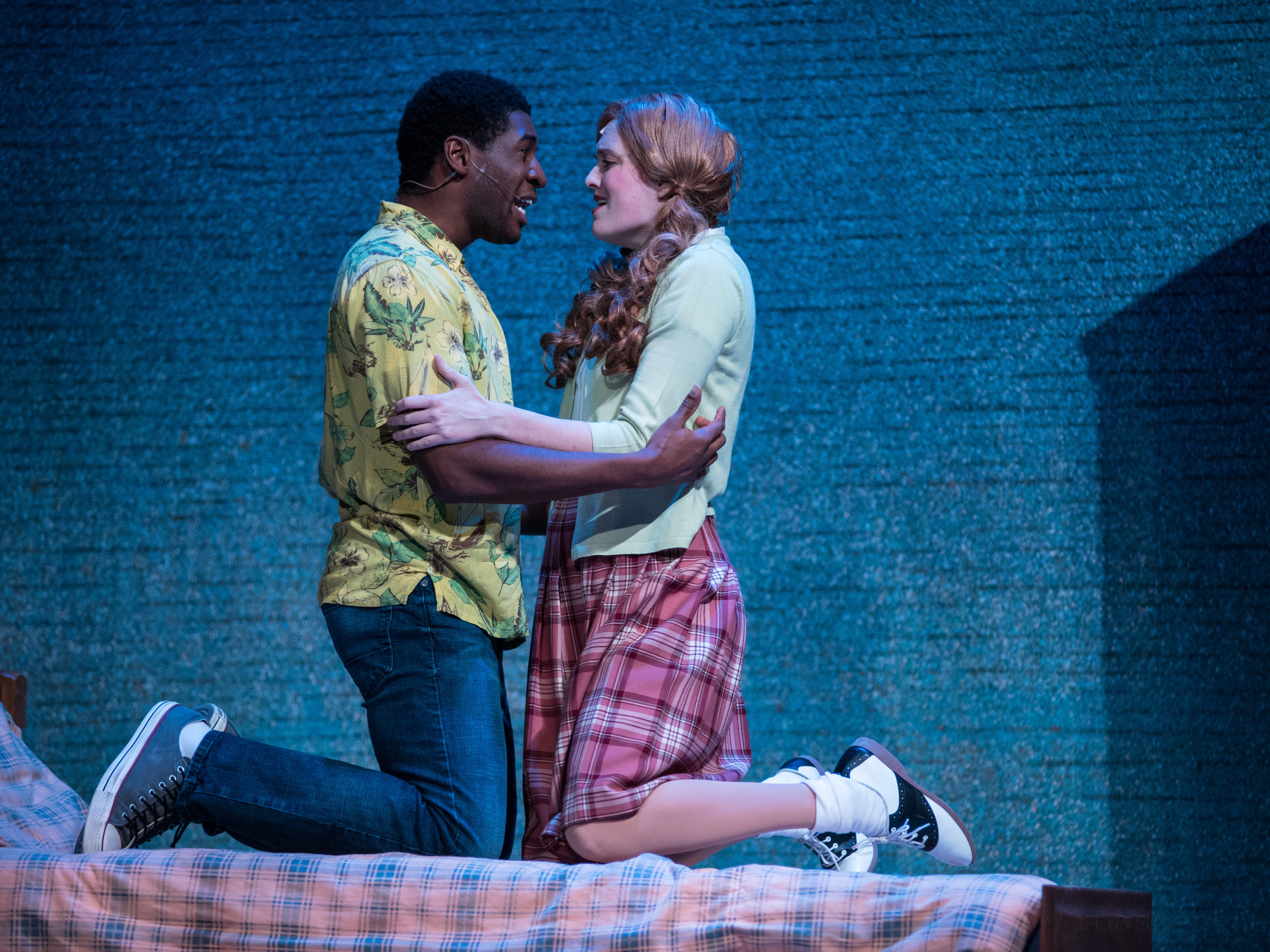 """Gilbert Domally and Ann Delaney embrace in Skylight Music Theatre's """"Hairspray."""""""