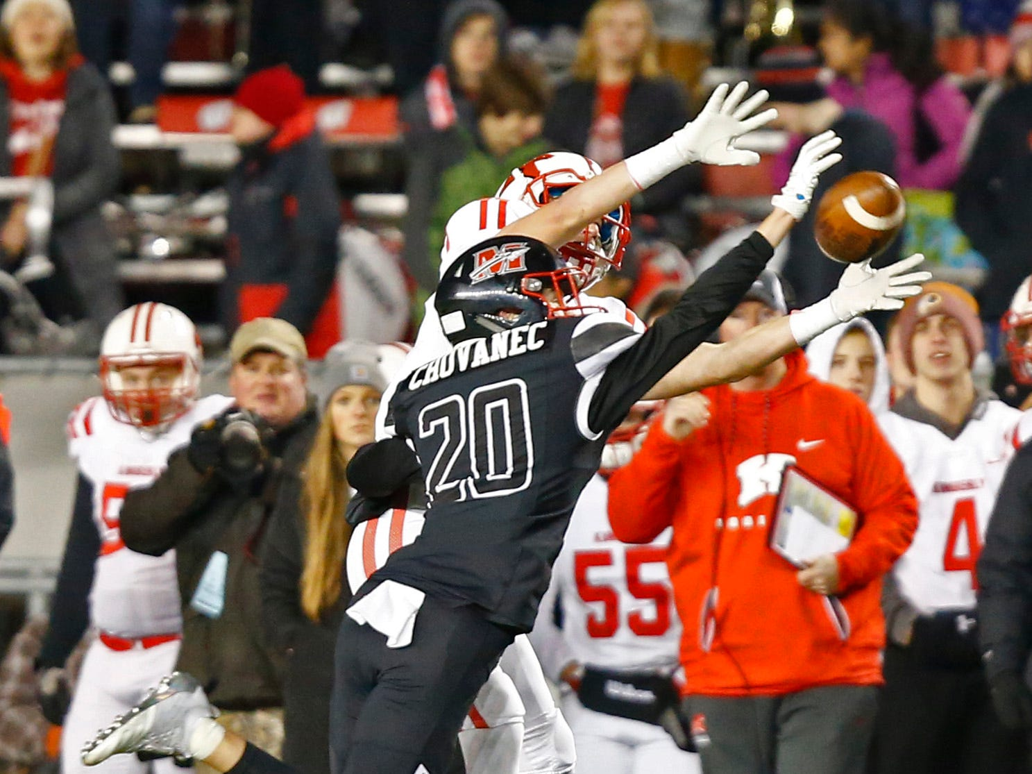 Muskego's Sam Chovanec blocks a pass intended for Kimberly's Connoe Wnek during the WIAA Division 1 championship.