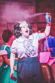 "Maisie Rose applies the title product in Skylight Music Theatre's ""Hairspray,"" which ends its run at the Broadway Theatre Center Sunday."