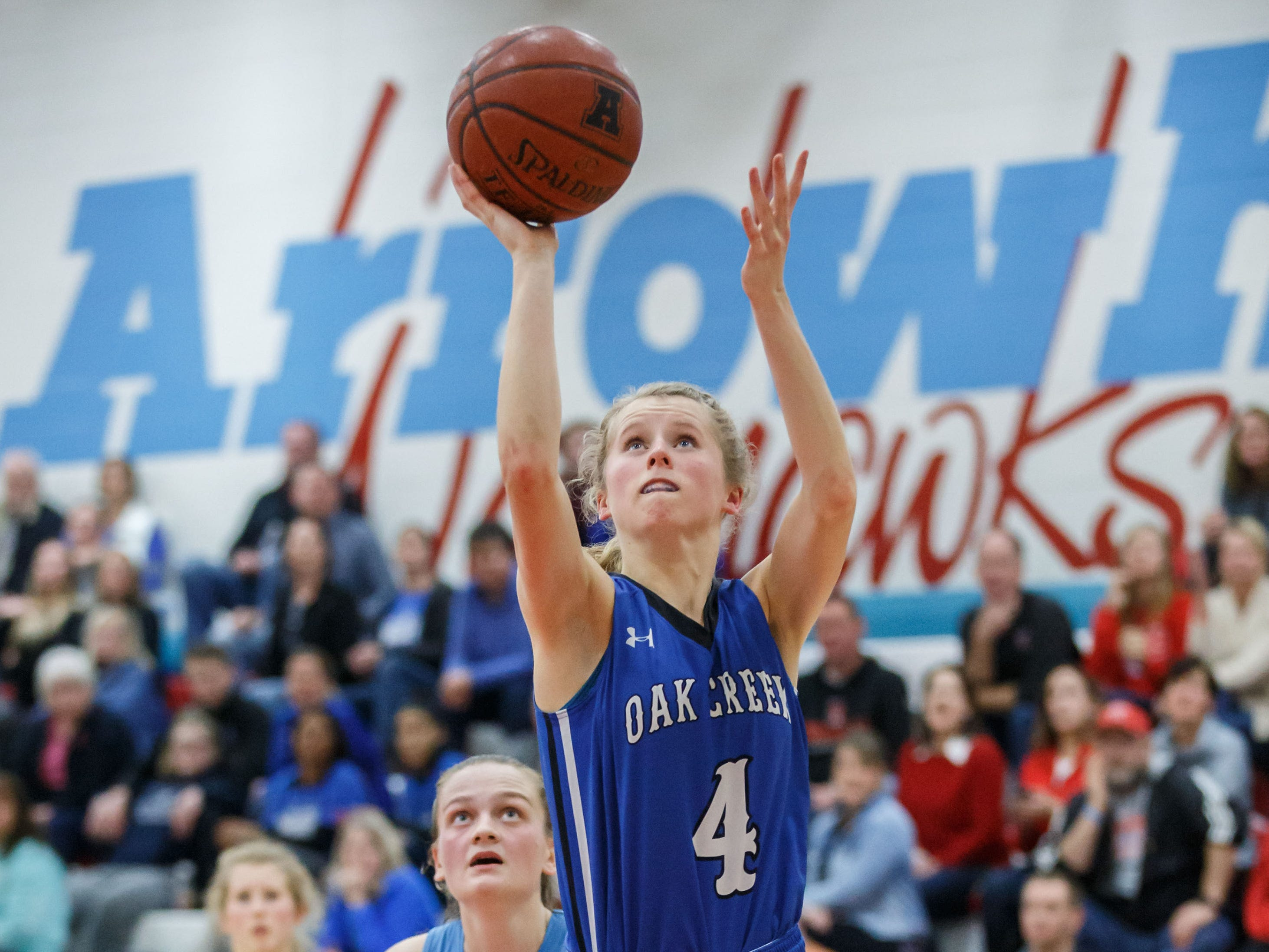 Oak Creek senior Maddie Gard (4) elevates for a shot during the game at Arrowhead on Friday, Nov. 16, 2018.