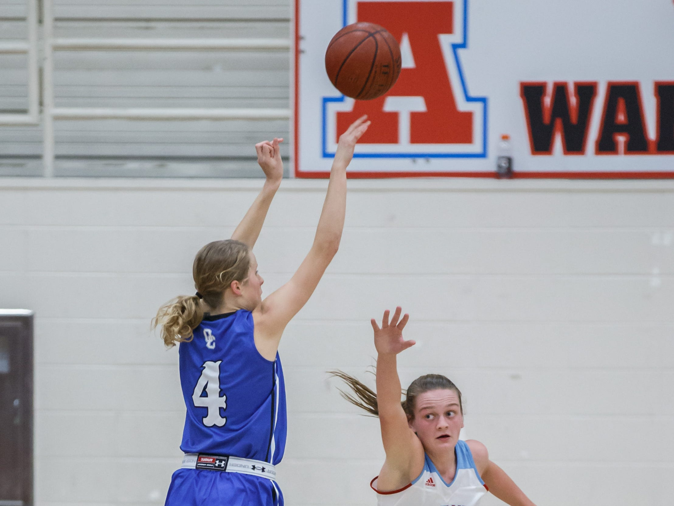 Oak Creek senior Maddie Gard (4) elevates for three over Arrowhead's Phoebe Frentzel (15) during the game in Hartland on Friday, Nov. 16, 2018.