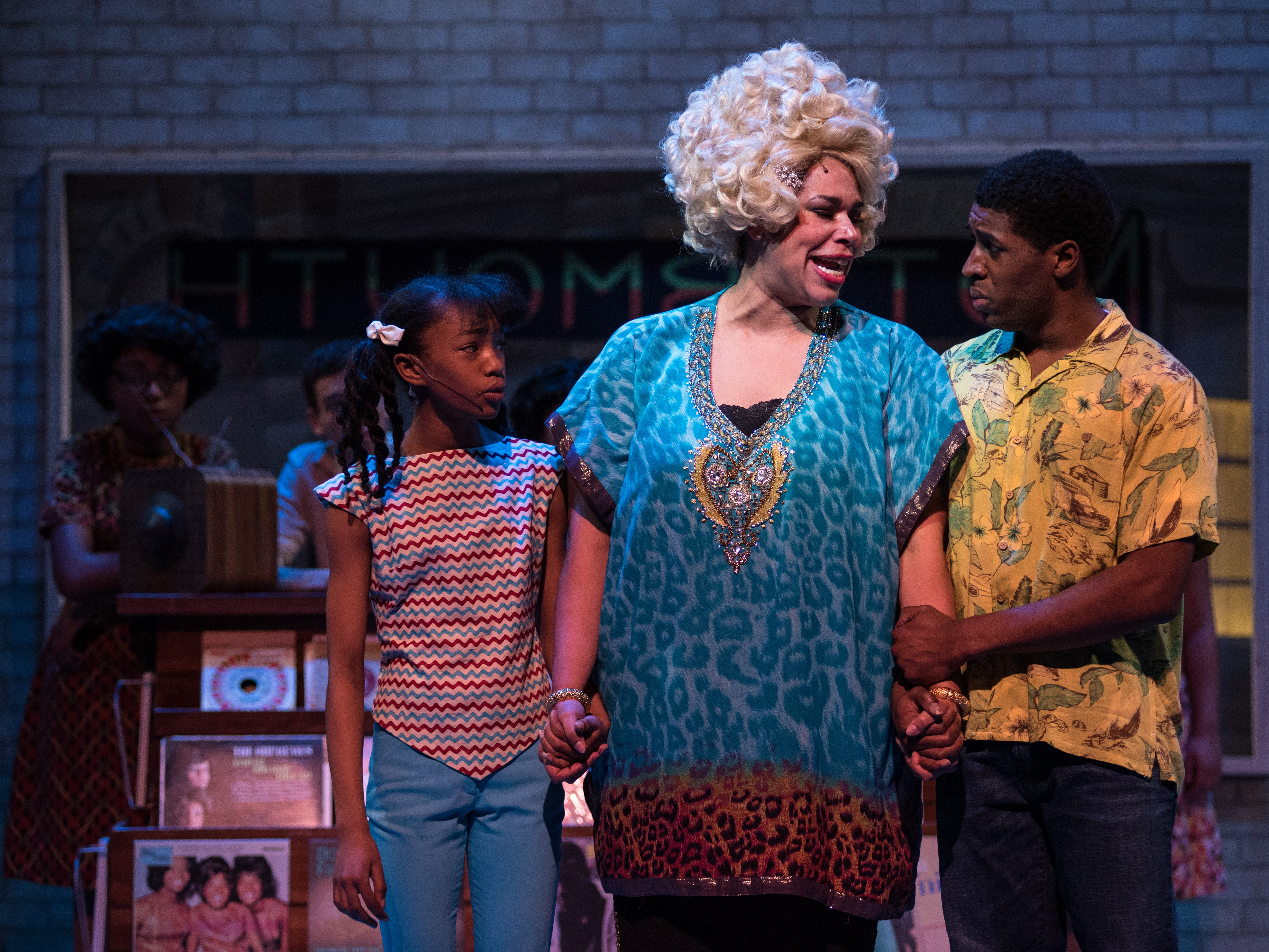 """Terynn Erby-Walker (left), Bethany Thomas and Gilbert Domally share a moment in Skylight Music Theatre's """"Hairspray."""""""