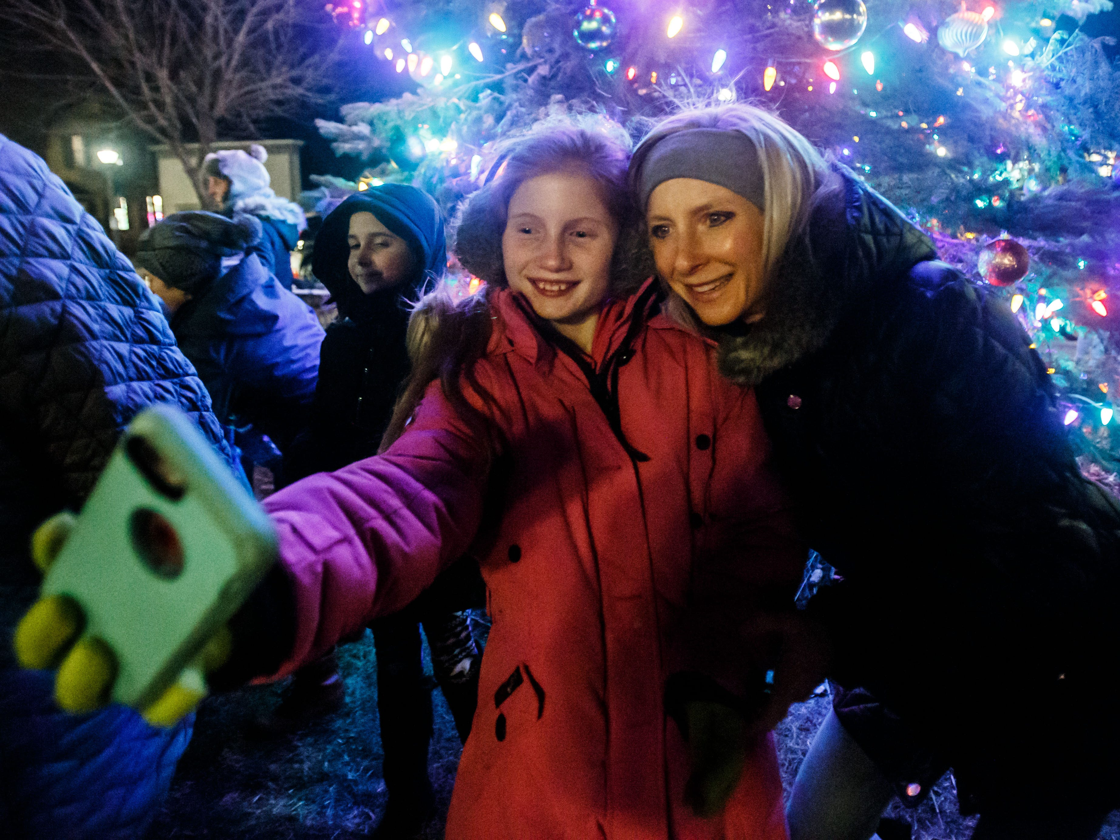Kendall Kontranowski, 10, of Delafield, takes a selfie with her mom Kristin during the annual Delafield Tree Lighting event on Friday, Nov. 16, 2018. The event, hosted by the City of Delafield Tourism, featured live music, free cookies, hot cocoa and more.