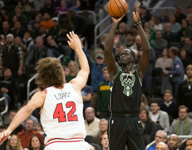 Bucks forward Thon Maker shoots over Chicago Bulls center Robin Lopez.
