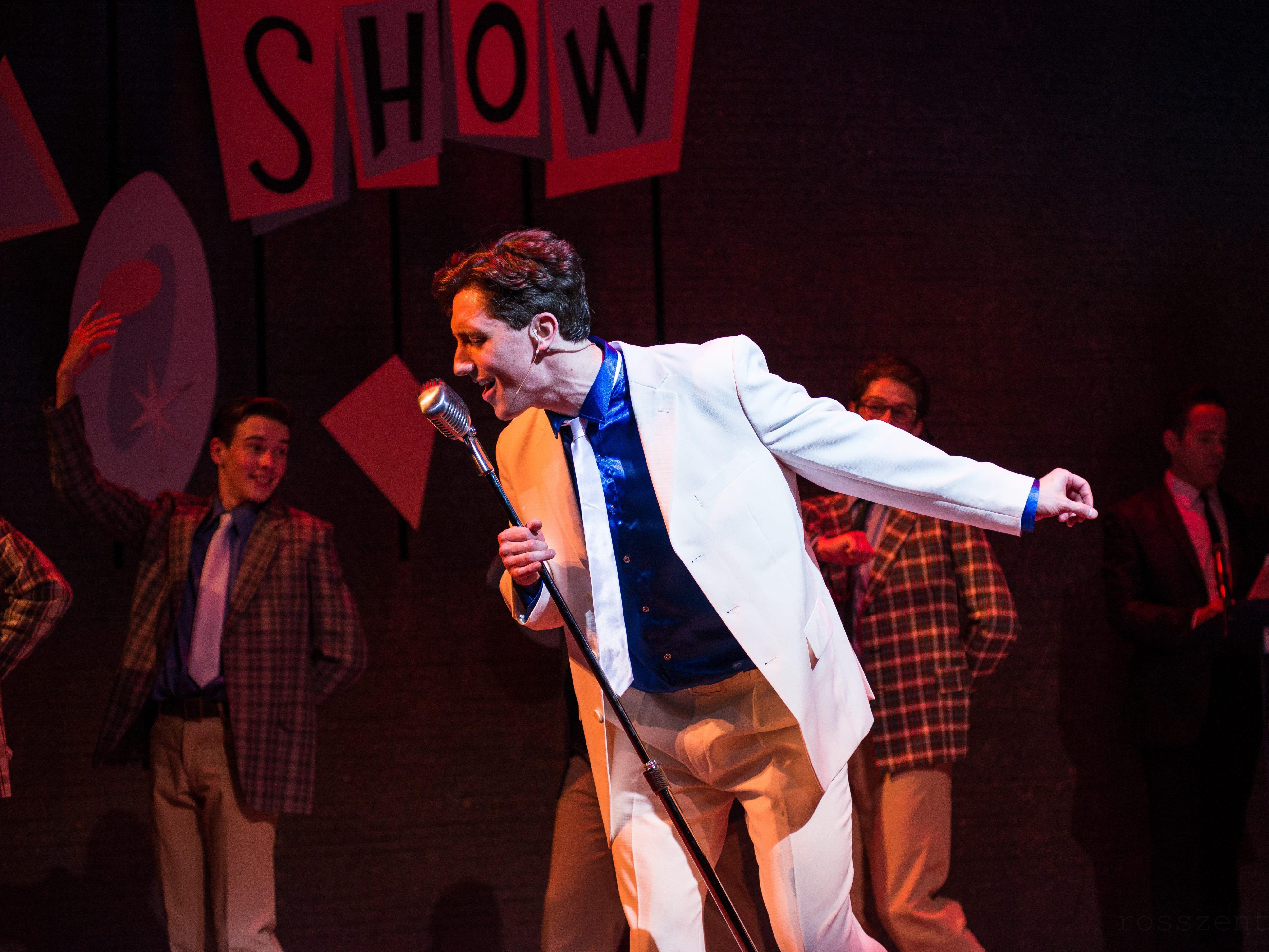 "Colin Schreier sings in Skylight Music Theatre's ""Hairspray."""