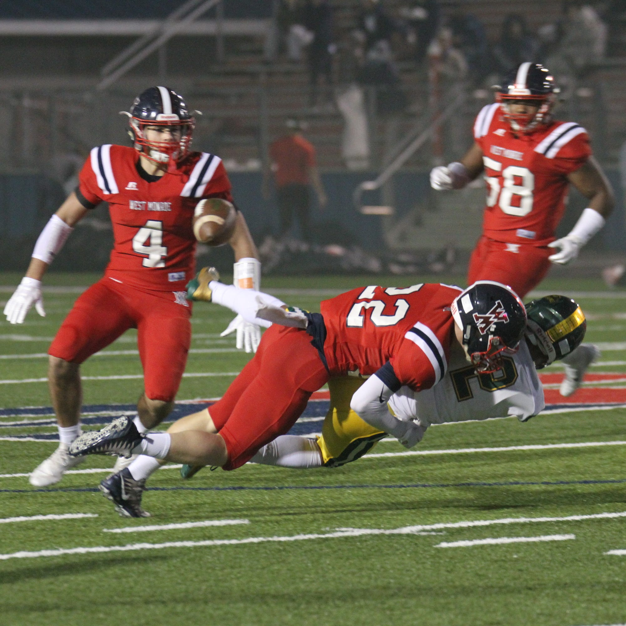 West Monroe senior cornerback Zak Knox (22) causes a fumble during the second round playoff game against Captain Shreve Friday, Nov. 16, 2018 at Rebel Stadium.