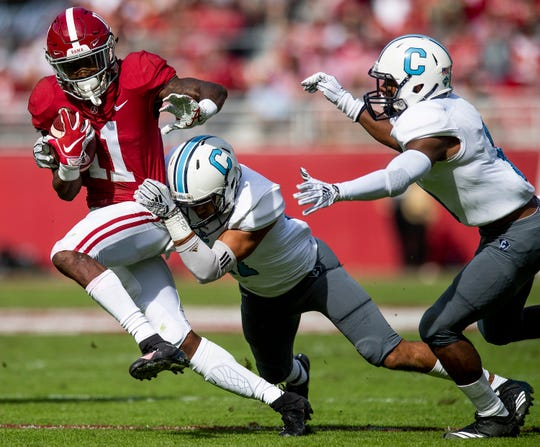Alabama wide receiver Henry Ruggs, III, (11) is stopped by Citadel defensive back Chris Beverly (17) In first half action at Bryant-Denny Stadium in Tuscaloosa, Ala., on Saturday November 17, 2018.