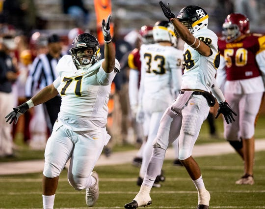 Autauga's Elijah Elmore (71) and Dominique Webster (88) celebrate a tackle for a loss against Escambia in the AISA Class AA State Championship game in Troy, Ala., on Friday November 16, 2018.