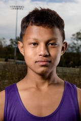 Suraj Rai, Nepal,  a member of the Aiken Cross Country Team poses for a portrait on Thursday, Oct. 25, 2018, at Aiken High School in Cincinnati.