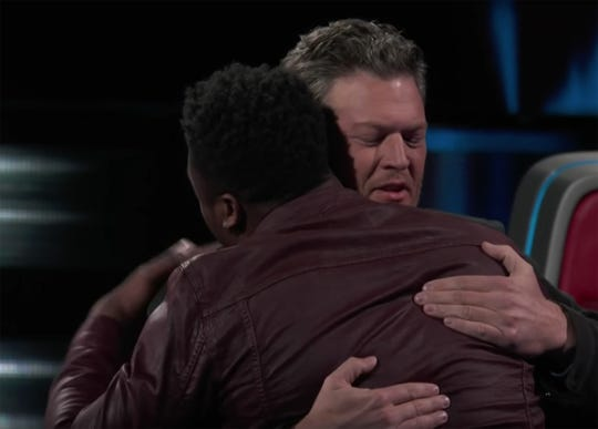 "Kirk Jay hugs his coach Blake Sheton on Tuesday after learning that Jay had been saved by America's vote on NBC's ""The Voice."""