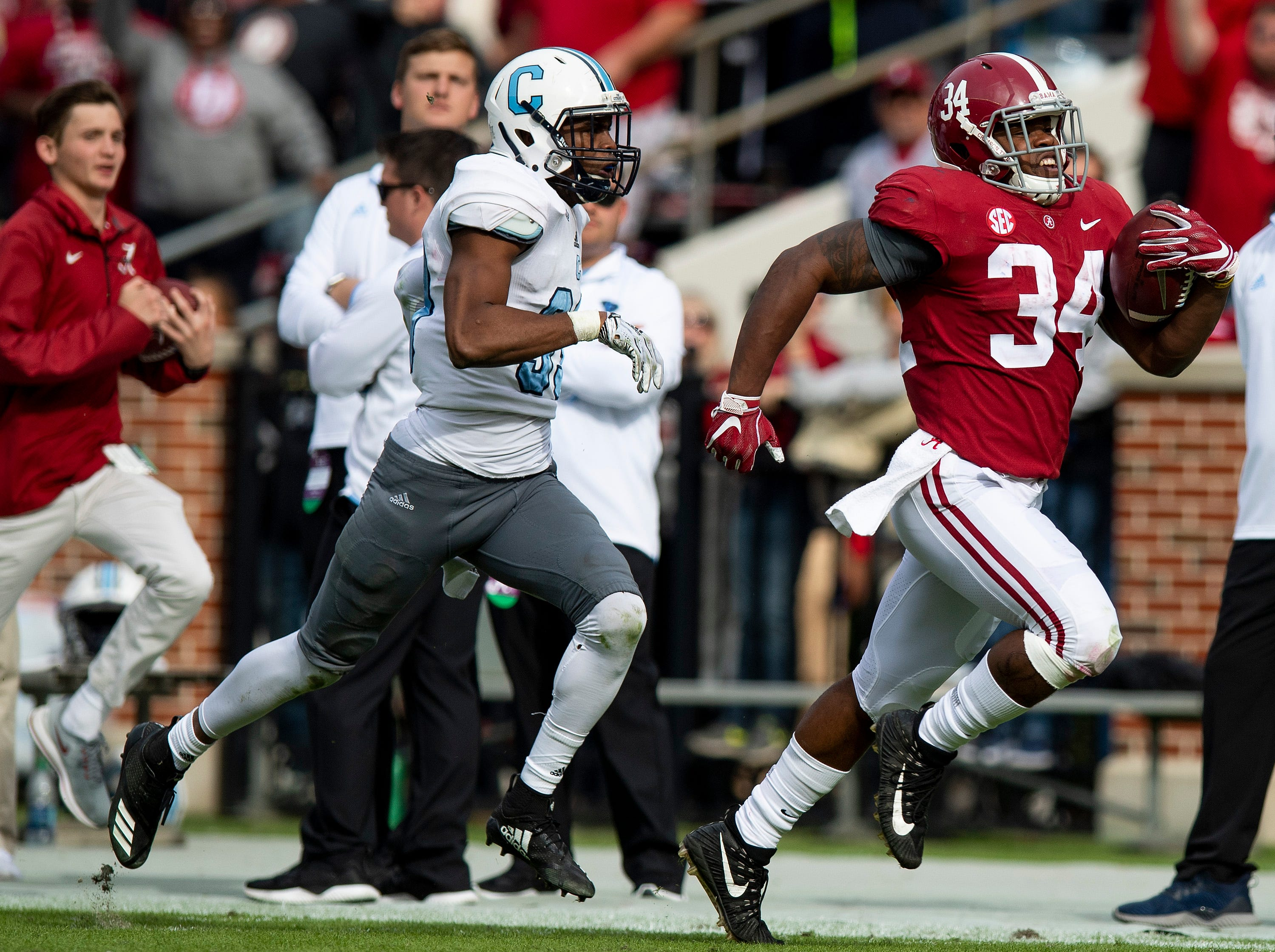 Citadel defensive back Ronald Peterkin (33)  chases down Alabama running back Damien Harris (34) in second half action at Bryant-Denny Stadium in Tuscaloosa, Ala., on Saturday November 17, 2018.