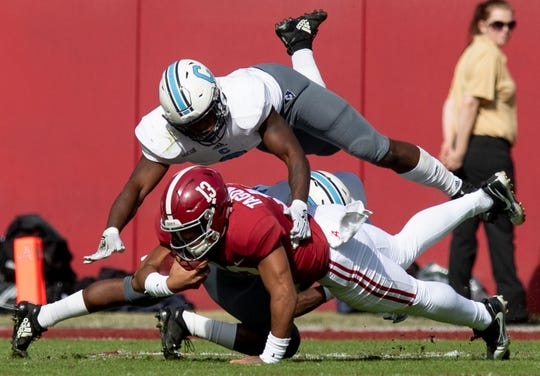 Citadel defensive back Joshua Bowers (3) and linebacker Willie Eubanks, III, stop Alabama quarterback Tua Tagovailoa (13) after a short gain In first half action at Bryant-Denny Stadium in Tuscaloosa, Ala., on Saturday November 17, 2018.