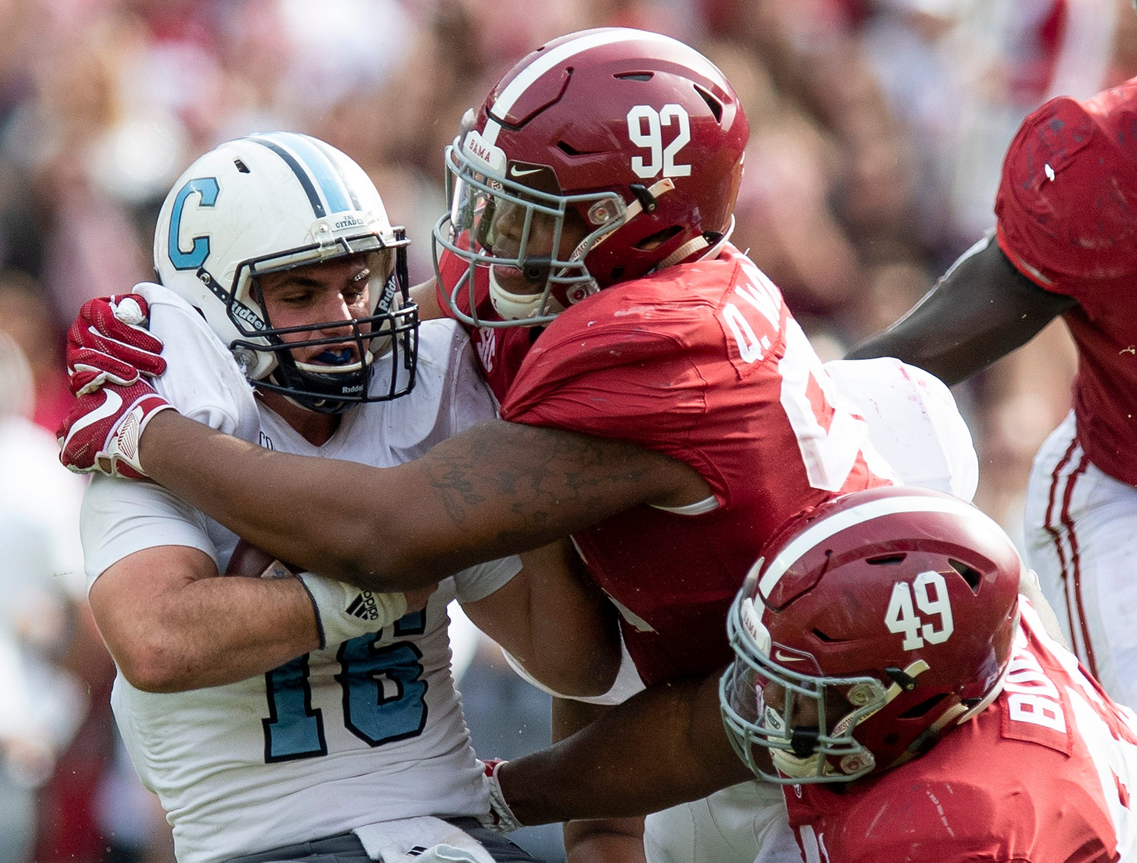 Alabama defensive lineman Quinnen Williams (92) and defensive lineman Isaiah Buggs (49) stop Citadel quarterback Brandon Rainey (16) in second half action at Bryant-Denny Stadium in Tuscaloosa, Ala., on Saturday November 17, 2018.