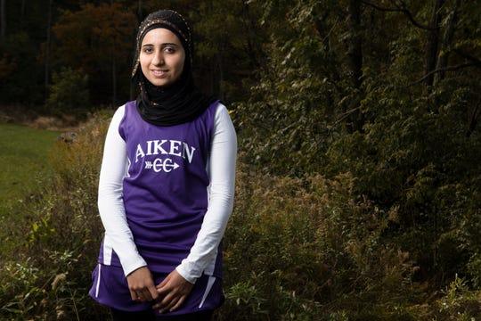 Amal Masto, Syria,  a member of the Aiken Cross Country Team poses for a portrait on Thursday, Oct. 25, 2018, at Aiken High School in Cincinnati.