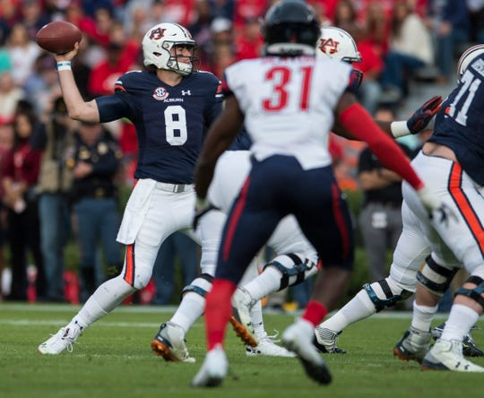 Auburn quarterback Jarrett Stidham (8) drop back to throw the ball against Liberty at Jordan-Hare Stadium in Auburn, Ala., on Saturday, Nov.. 17, 2018.