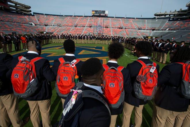Auburn players pray on the field before taking on Liberty at Jordan-Hare Stadium in Auburn, Ala., on Saturday, Nov.. 17, 2018.