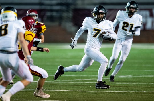 Autauga's Krys Chapman (7) returns a punt against Escambia in the AISA Class AA State Championship game in Troy, Ala., on Friday November 16, 2018.