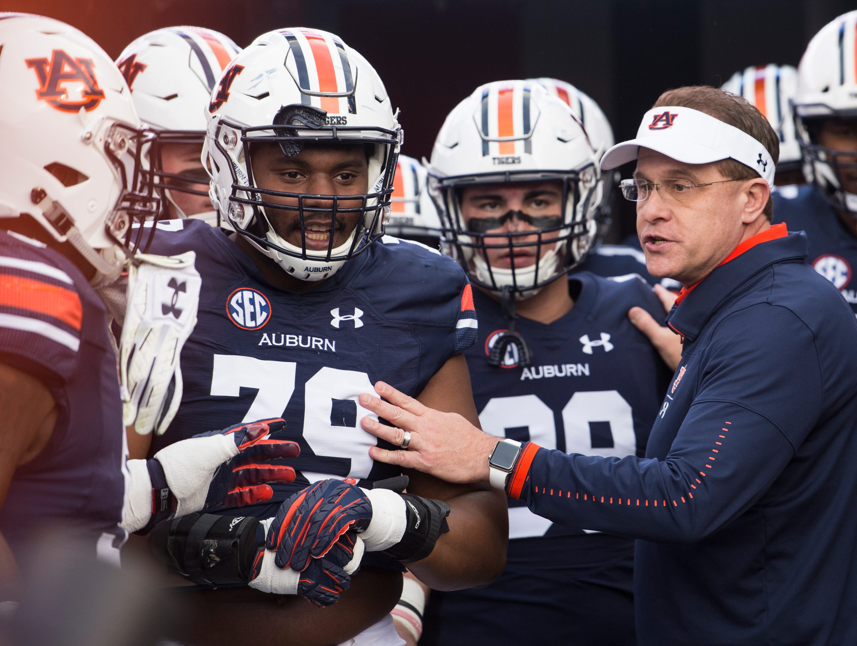Auburn head coach Gus Malzahn talks with his players, led by senior defensive tackle Andrew Williams (79), before they take the field at Jordan-Hare Stadium in Auburn, Ala., on Saturday, Nov.. 17, 2018.