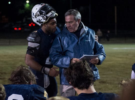 St. James' Tony Amerson (2) hugs his coach, Jimmy Perry, after the second round of the 3A playoff game at St. James High School in Montgomery, Ala., on Friday, Nov. 16, 2018. Providence Christian defeated St. James 27-6.