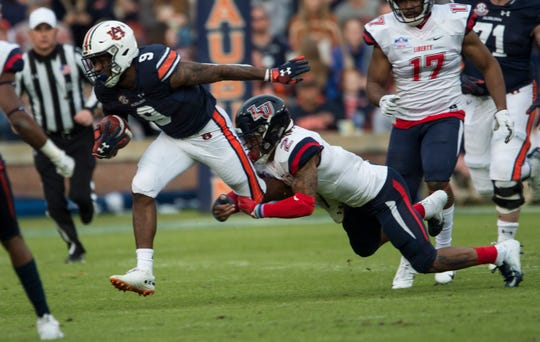 Auburn running back Kam Martin (9) runs the ball against Liberty at Jordan-Hare Stadium in Auburn, Ala., on Saturday, Nov.. 17, 2018. Auburn leads Liberty 32-0 at halftime.