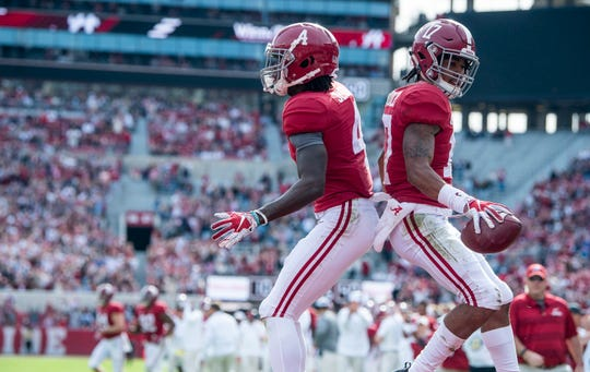 Alabama wide receiver Jaylen Waddle (17) and Alabama wide receiver Jerry Jeudy (4) celebrate Waddle's touchdown against The Citadel in second half action at Bryant-Denny Stadium in Tuscaloosa, Ala., on Saturday November 17, 2018.