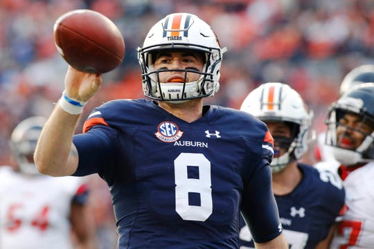 Nov 17, 2018; Auburn, AL, USA; Auburn Tigers quarterback Jarrett Stidham (8) tosses the ball to an official after scoring a touchdown against the Liberty Flames during the second quarter at Jordan-Hare Stadium. Mandatory Credit: John Reed-USA TODAY Sports