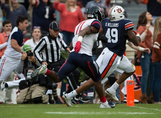 Auburn linebacker Darrell Williams (49) runs into the end zone after intercepting the ball against Liberty at Jordan-Hare Stadium in Auburn, Ala., on Saturday, Nov.. 17, 2018. Auburn leads Liberty 32-0 at halftime.