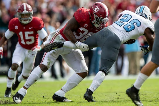 Alabama linebacker Mack Wilson (30) stops Citadel A-Back Keyonte Sessions (26) in second half action at Bryant-Denny Stadium in Tuscaloosa, Ala., on Saturday November 17, 2018.