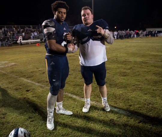 St. James' Tony Amerson (2) and St. James' Jacob Prickett (50) pose for a picture after the second round of the 3A playoff game at St. James High School in Montgomery, Ala., on Friday, Nov. 16, 2018. Providence Christian defeated St. James 27-6.