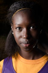 Kadia Sy, Senegal, a member of the Aiken Cross Country Team poses for a portrait on Thursday, Oct. 25, 2018, at Aiken High School in Cincinnati.