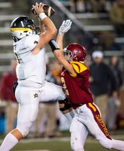 Autauga's Carson Tate (1) grabs a pass over Escambia's Chase Bell (2) in the AISA Class AA State Championship game in Troy, Ala., on Friday November 16, 2018.