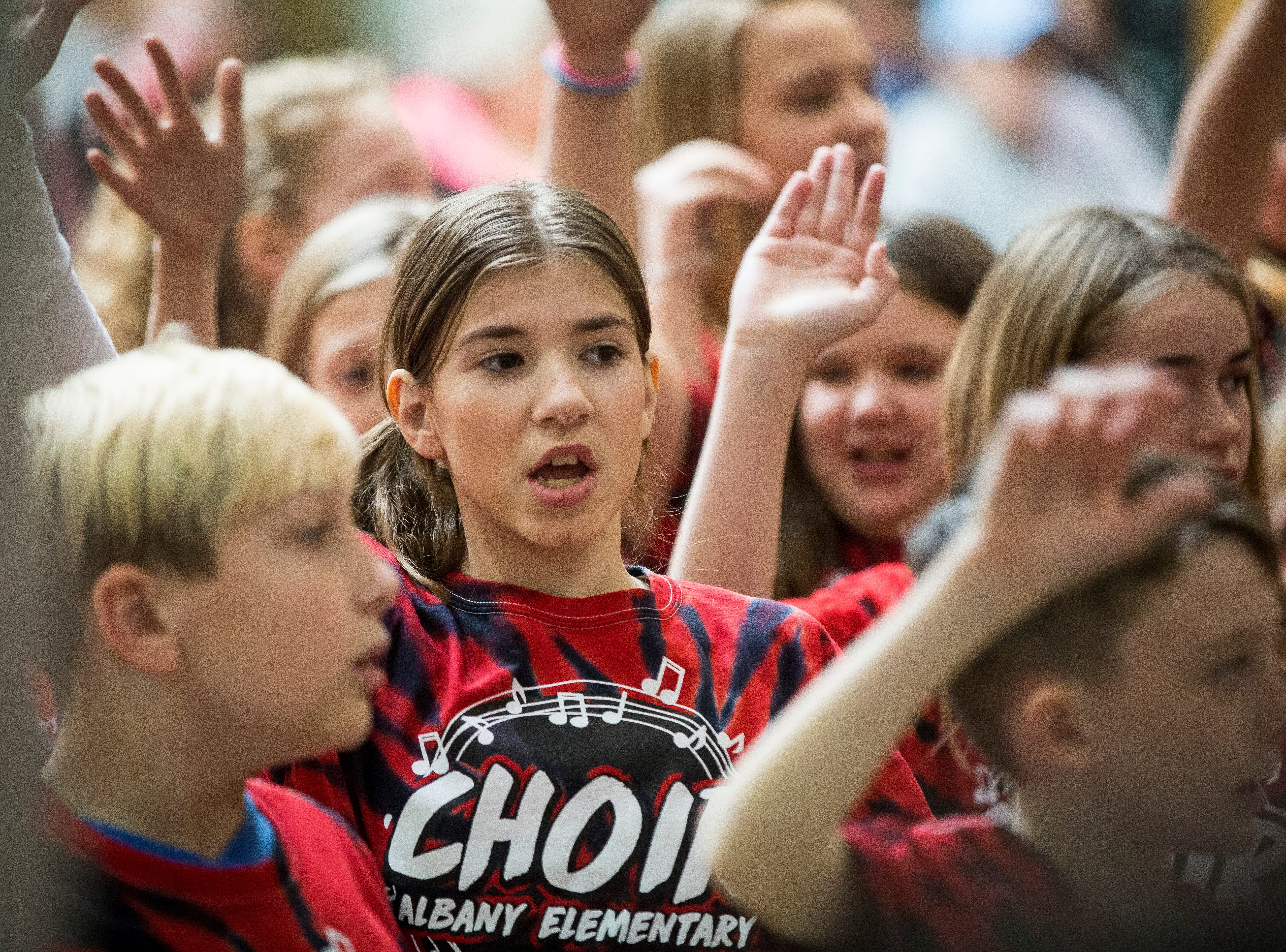 Children with Albany and Eaton elementary choirs sing to a crowd of people Saturday who were gathered for the Salvation Army's Red Kettle Campaign Kickoff at the Muncie Mall. The organization hopes to raise raise $207,000 through Christmas Eve.